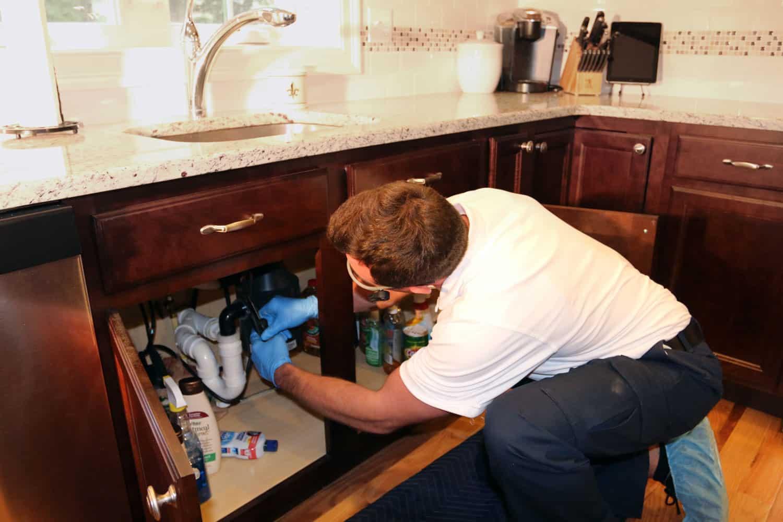 Tech under sink